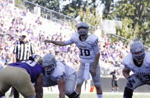 Tess Fox| Blot Magazine Junior quarterback Matt Linehan shouts instructions Sept. 10 against Washington in Seattle.